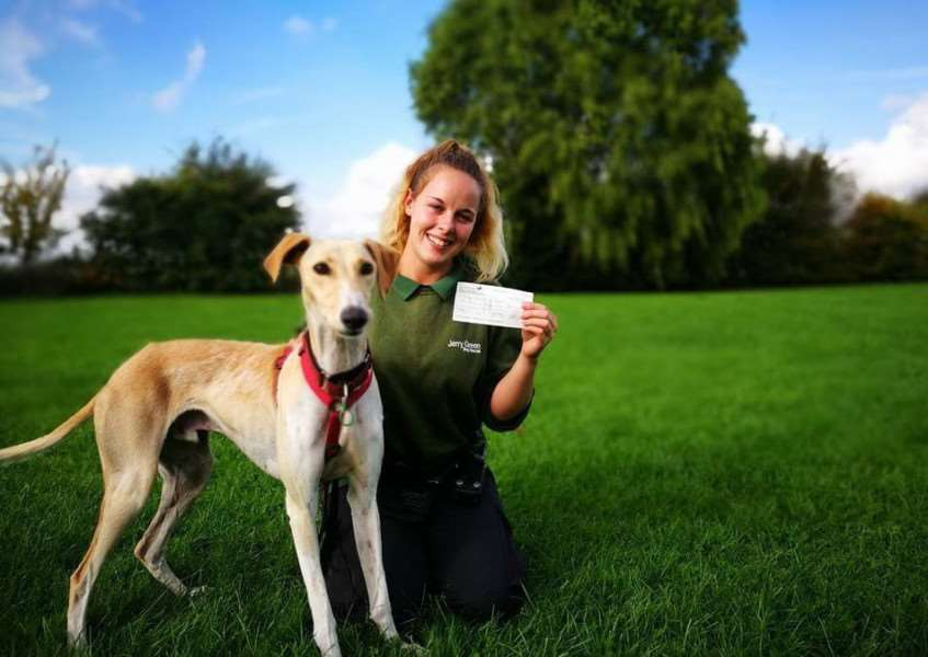 Dog Welfare Assistant Beth Stukins with the cheque donated to Jerry Green by a reader.