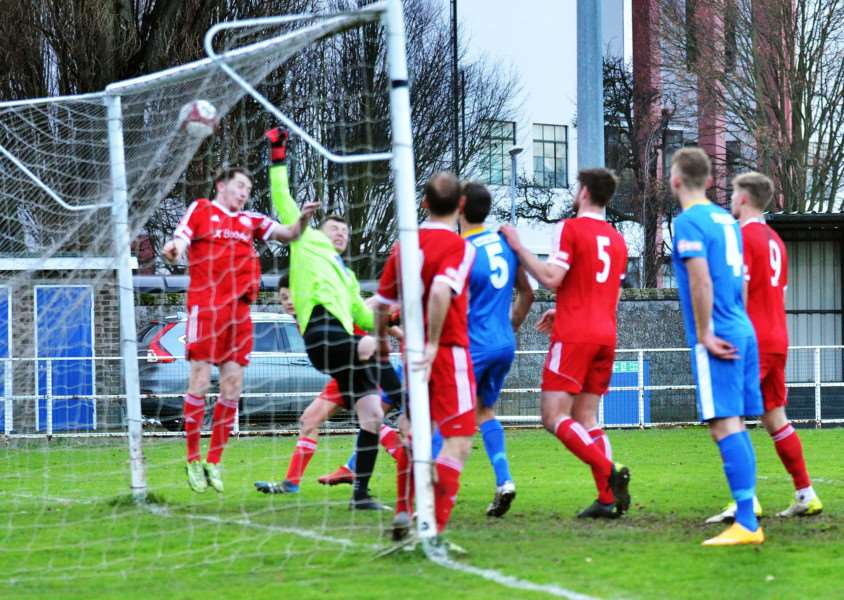 Goalkeeper Dan George pushed the ball into his own net as Spalding went 2-0 up