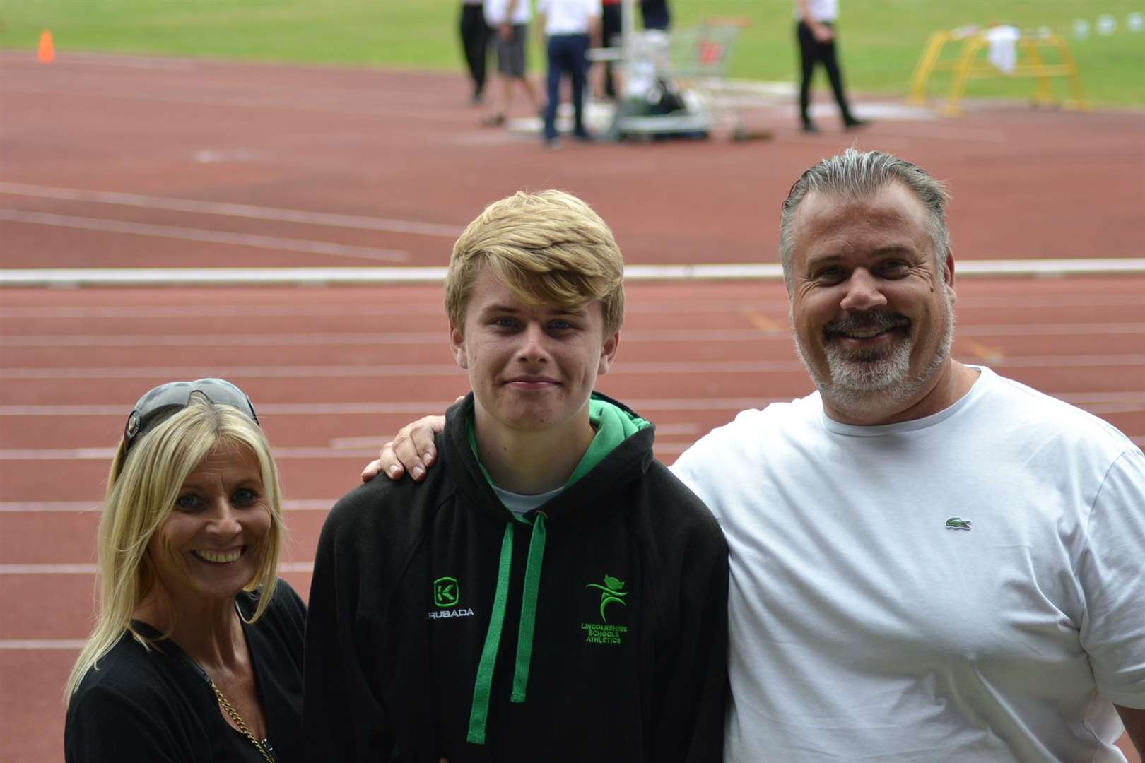 Donovan Capes with mum Samantha and dad/coach Lewis after winning the junior boys' shot put at the English Schools Track and Field Championships in BirminghamPhoto supplied.