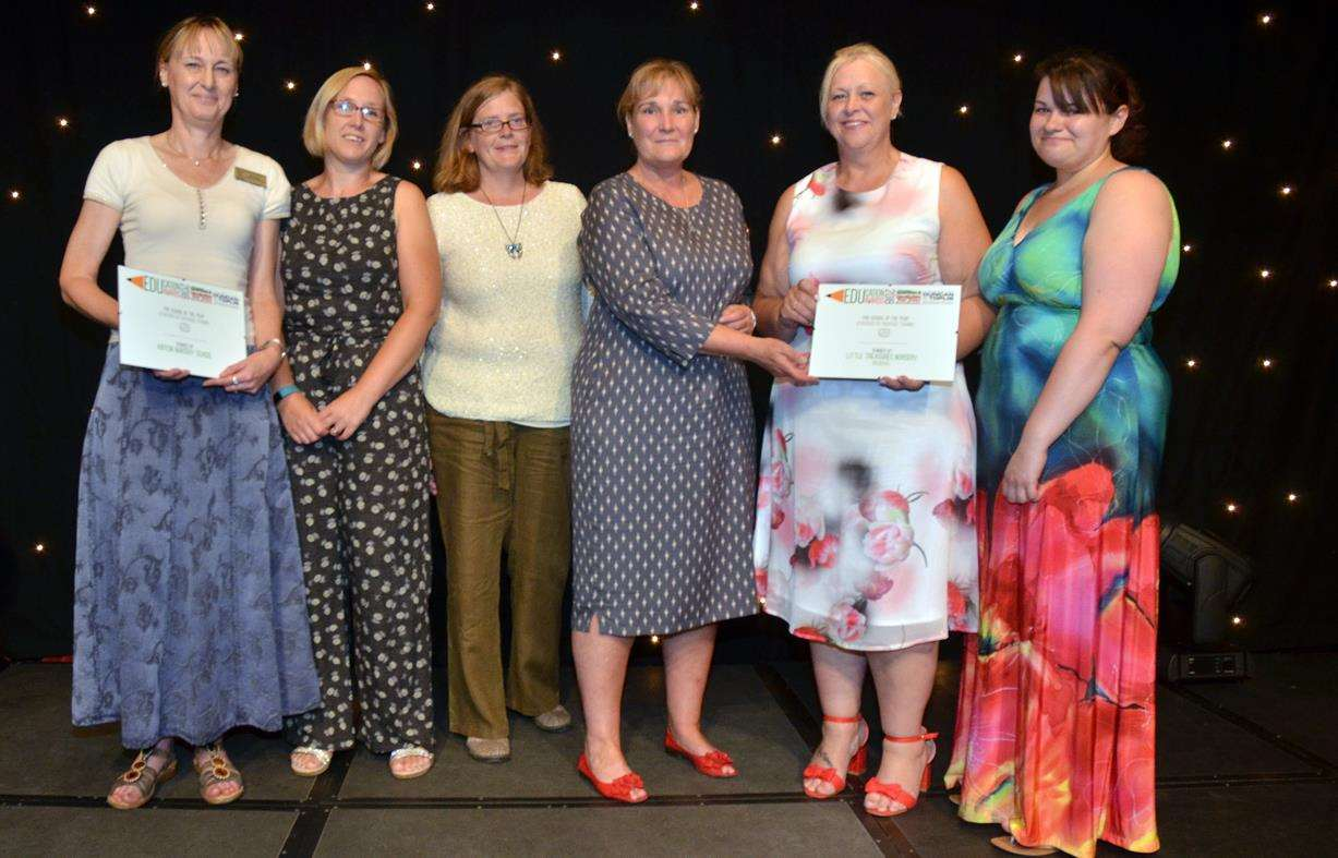 Staff from Kirton Nursery School and Little Treasures Nursery, Holbeach, with Suzie Bulbeck (third right), director of awards sponsors Riverside Training. Photo (TIM WILSON): 050718109SG.