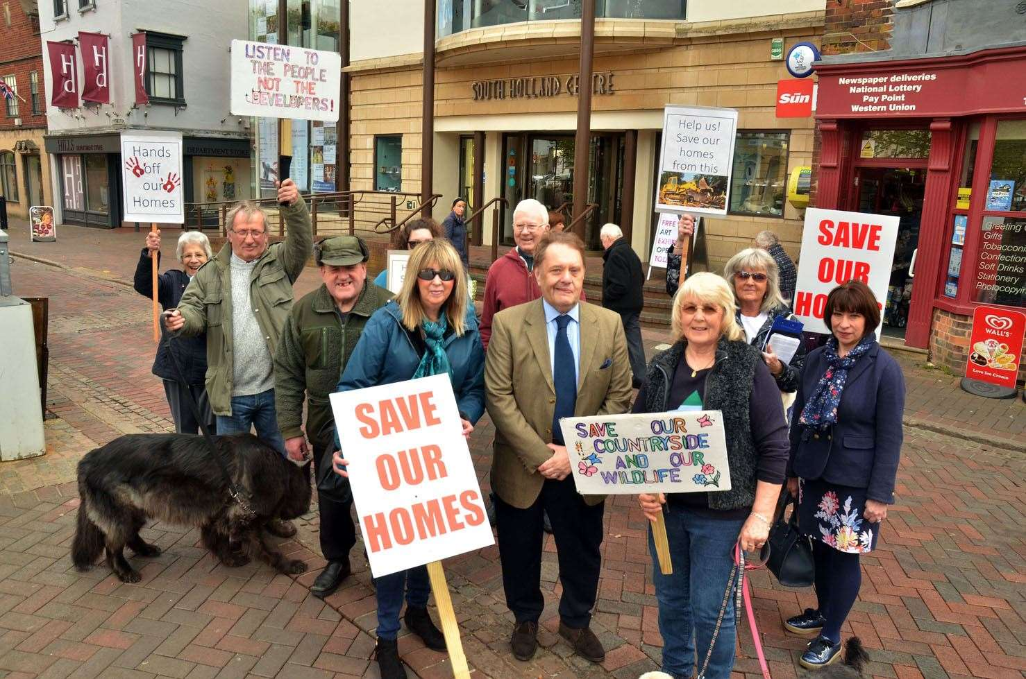 MP Sir John Hayes with relief road protesters outside The South Holland Centre, Spalding.