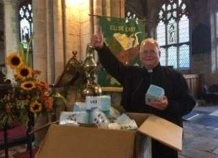 Father Jonathan Sibley, vicar of St Mary's Church, Long Sutton, with some of the free face masks available from LCVS.Photo supplied. (42840122)