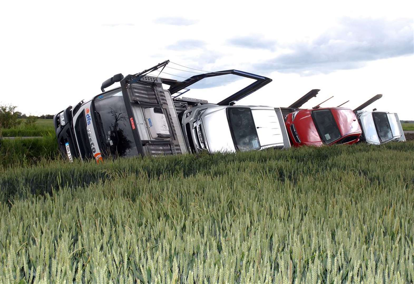 Transporter carrying vehicles falls into ditch near Whaplode Drove