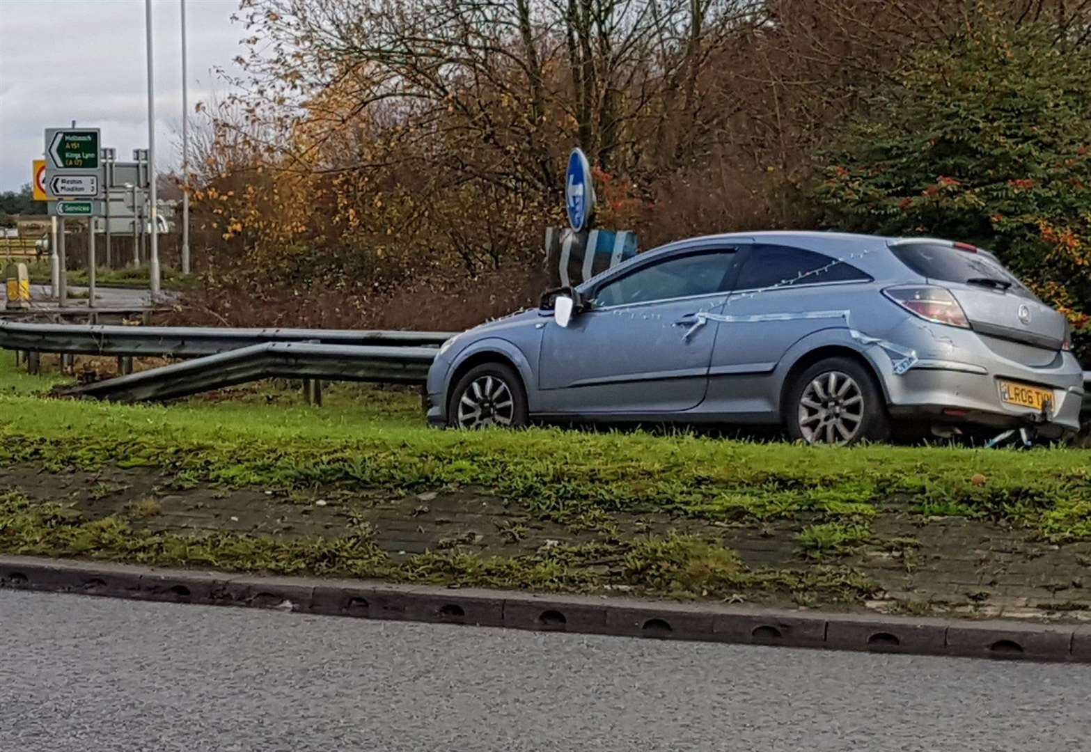 Work starts to remove Christmas lights car from roundabout
