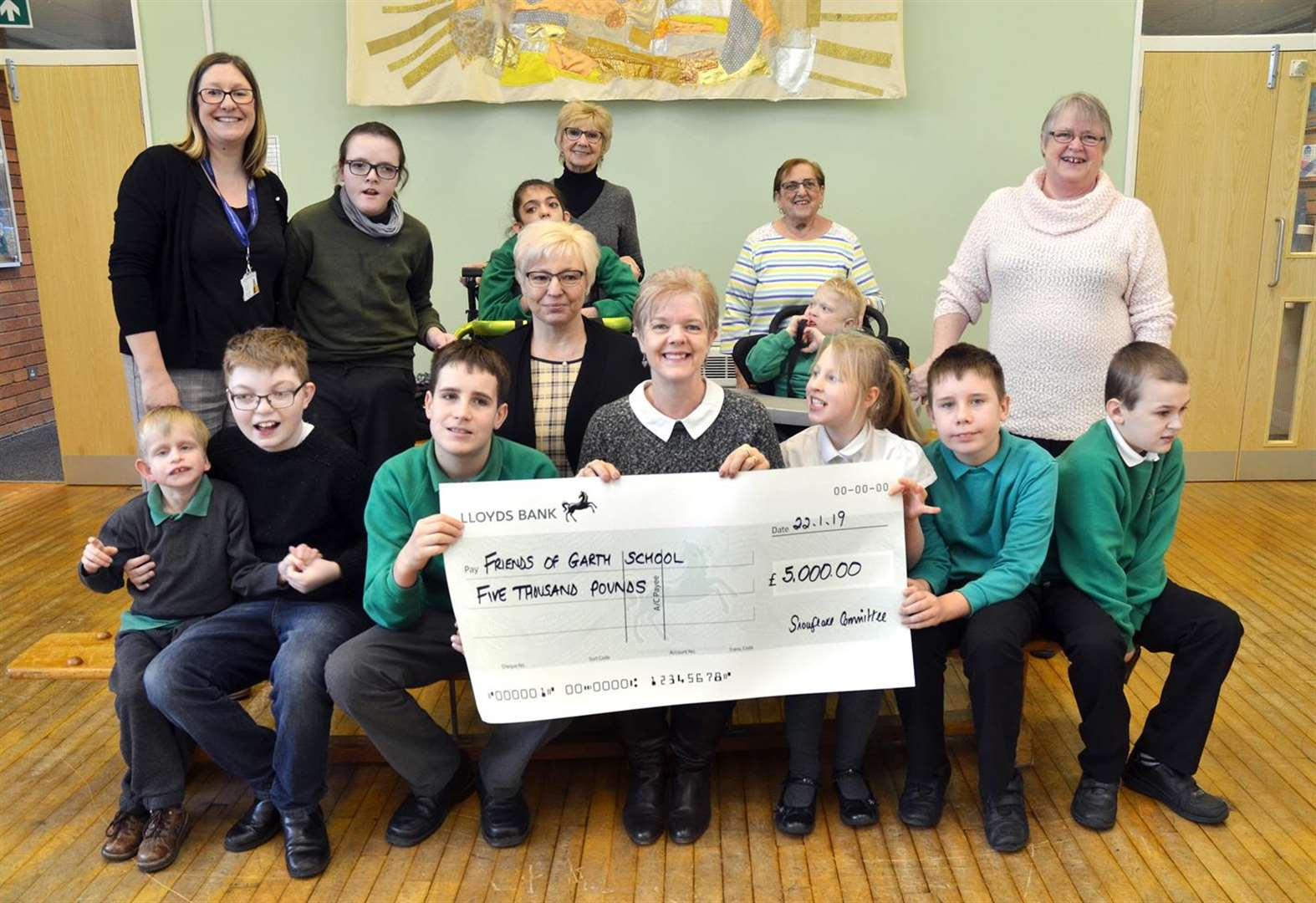 Slimmers raise cash for Garth School