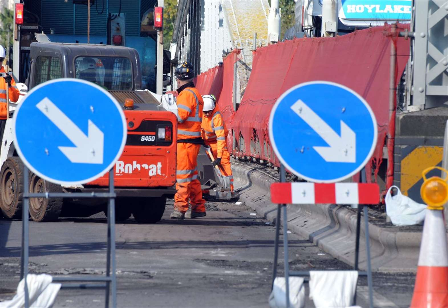 Work starts to repair sunken manhole on busy road