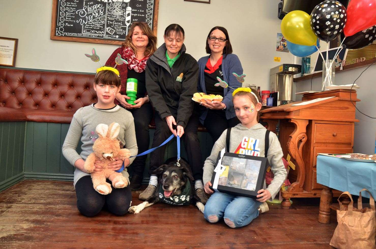 The Barber Shoppe in Holbeach present money raised from their raffle to Jerry Green. Pictured: Staff Deborah Wright, Jerry Green community fundraiser Liz Hinckley with 'ambassadog' Stella and Karen Elsey. Front: Leah Eley and Chloe Eynott. (8546874)