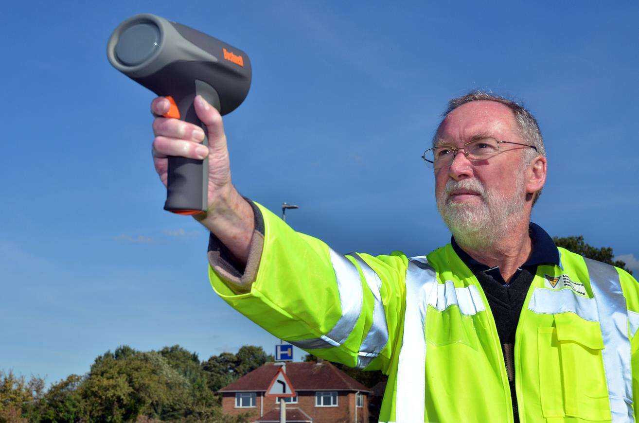 UP TO SPEED: Mike Harris with the hand-held speed device. Photo (TIM WILSON): SG-250918-008TW