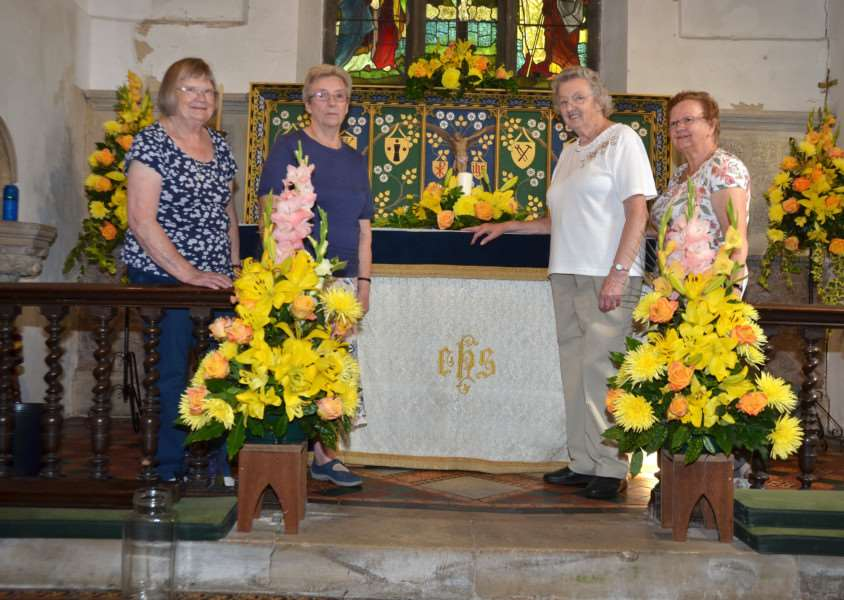 "Joyce Mayne, Doreen Scrimshaw, June Stanton and Pat Saxton at St Nicholas Church, Lutton, for its ""Headline News in Flowers"" Festival. Photo by Tim Wilson. SG270817-145TW."