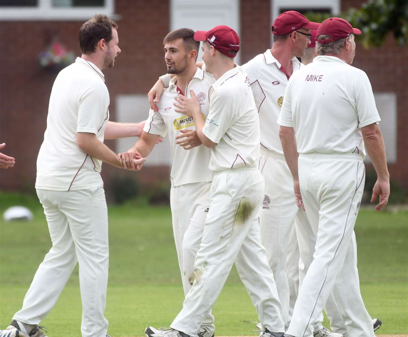 Alex Baker congratulated by Harrox teammates after taking a wicket. Photo by Adam Fairbrother. SG-030819-026AF