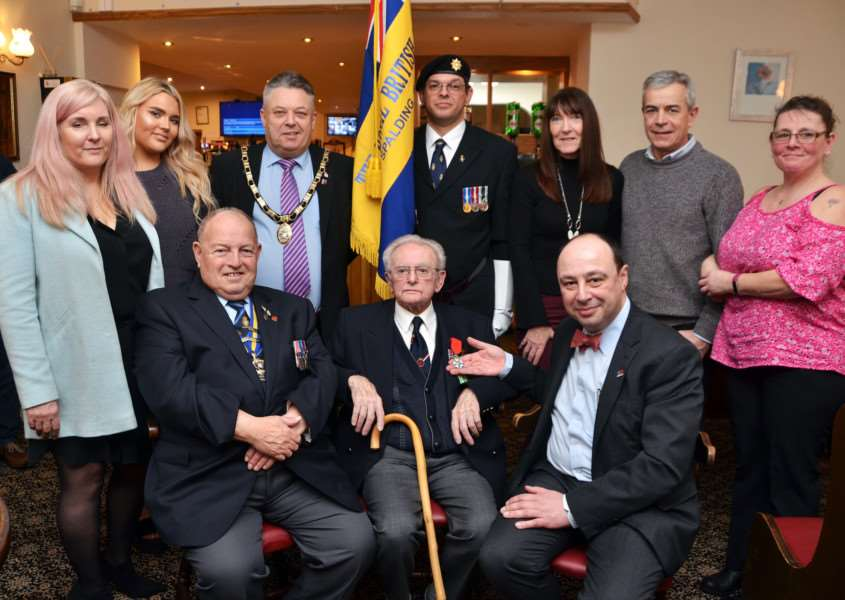 Ted West, centre front, with Jean-Claude Lafontaine (right), Tony Goodwin (left) and, from left, back: Beverley West, Tegan Mickleburgh, district council chairman Coun Rodney Grocock, Graham Hewitt, Diane Whitelaw, Alan West and Michelle Henderson. SG190118-447TW