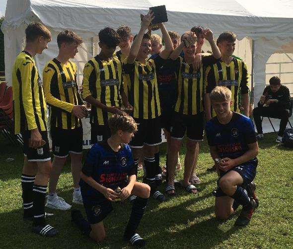 Holbeach United U15 Yellows lifting the cup after winning the Hungate tournament