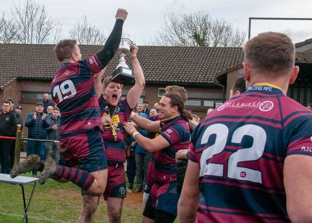 Spalding captain Dan Adams celebrates with team-mates after lifting the Midlands RFU Senior Vase at Dunstablians.Photo by Adrian Smith.