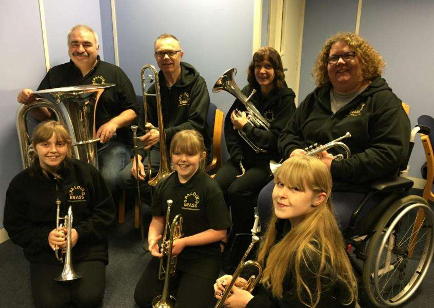 Pictured above: Band chairman Richard Key, Simon Templer, Julie Key, Jacqui Templer, and younger members Tiffany, Megan and Courtney. Photo supplied.