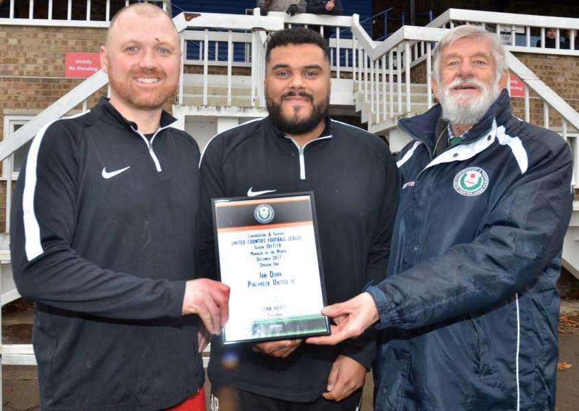 Player-manager Ian Dunn and assistant Allan Ross receive a monthly award from UCL chairman John Weeks