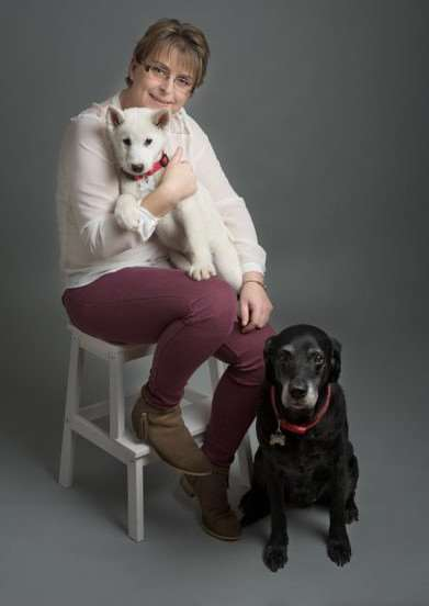 Whaplode photographer Marie Sampson, with her dogs Jazz (white) and Missy, is running in this year's London Marathon for the charity Remember My Baby. Photo by Emma Charlton of Little Cherubs Photography, March.