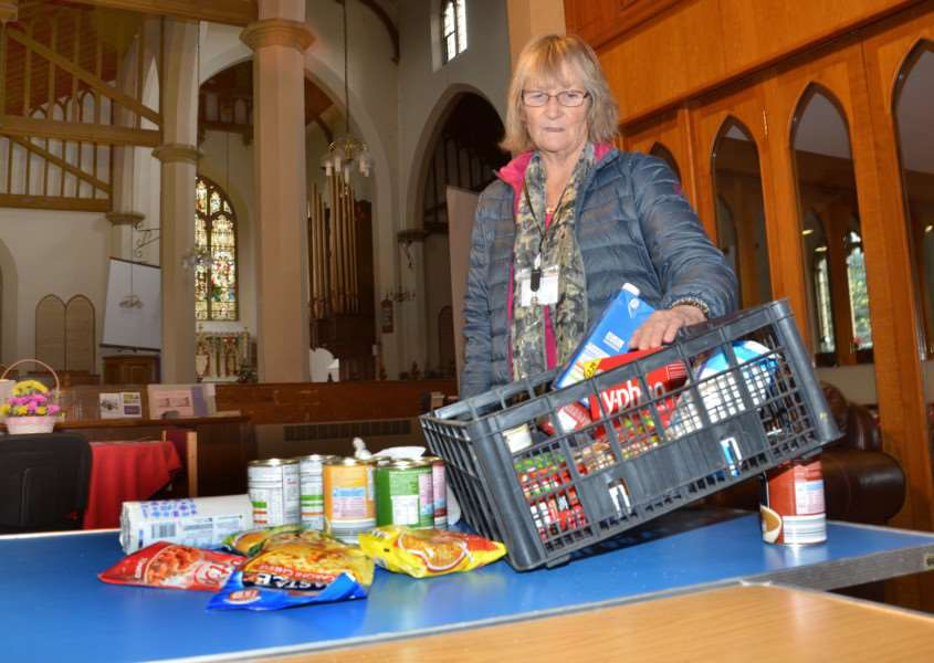 FOOD SHELTER: A volunteer at Sutton Bridge Foodbank with some of the donations made at St Matthew's Church. Photo by Tim Wilson. SG281117-132TW.