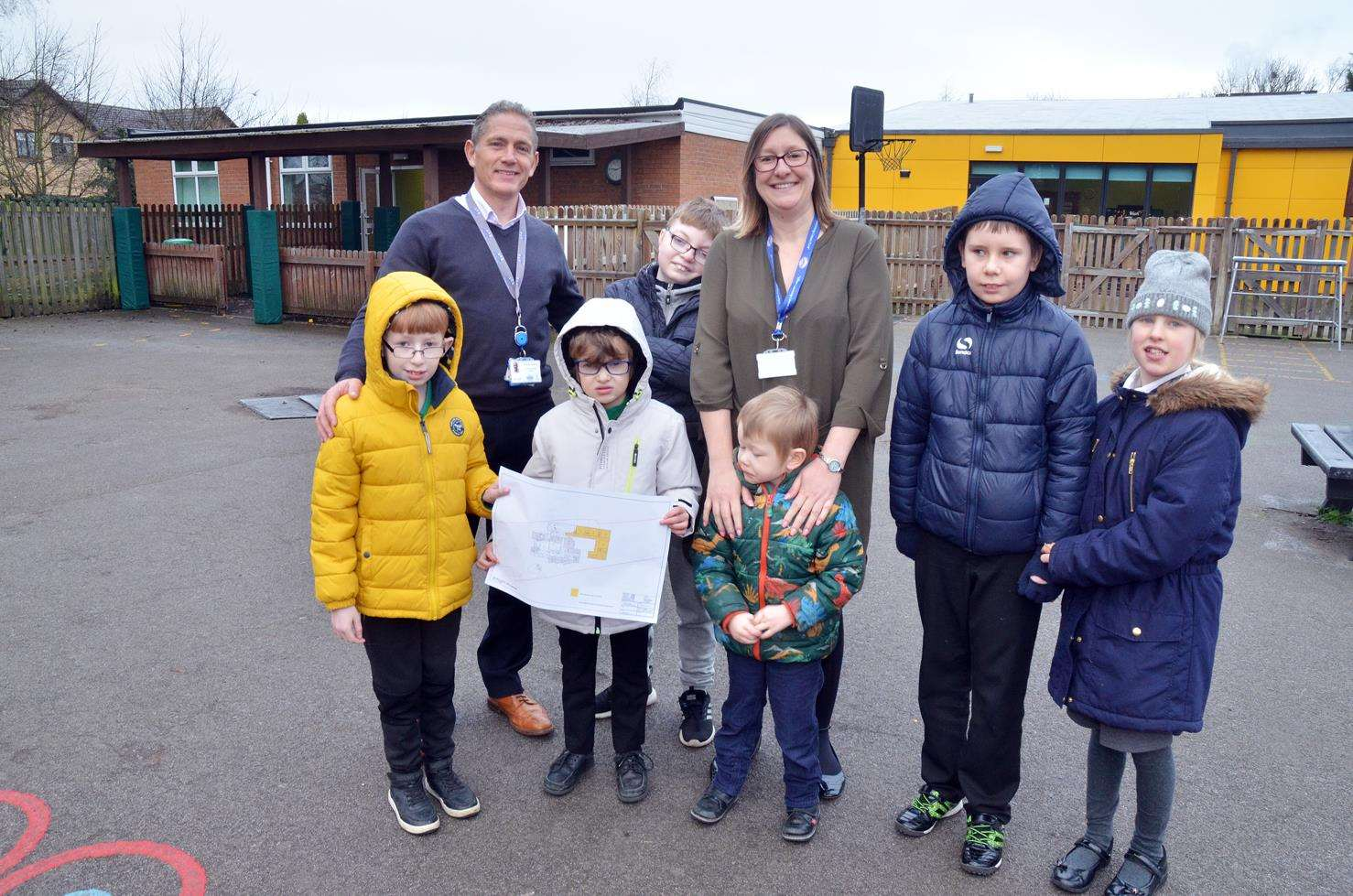 Executive head teacher Daran Bland, head teacher Claire Ball and pupils on the site of new build at Garth School. Photo (TIM WILSON): 230119-6