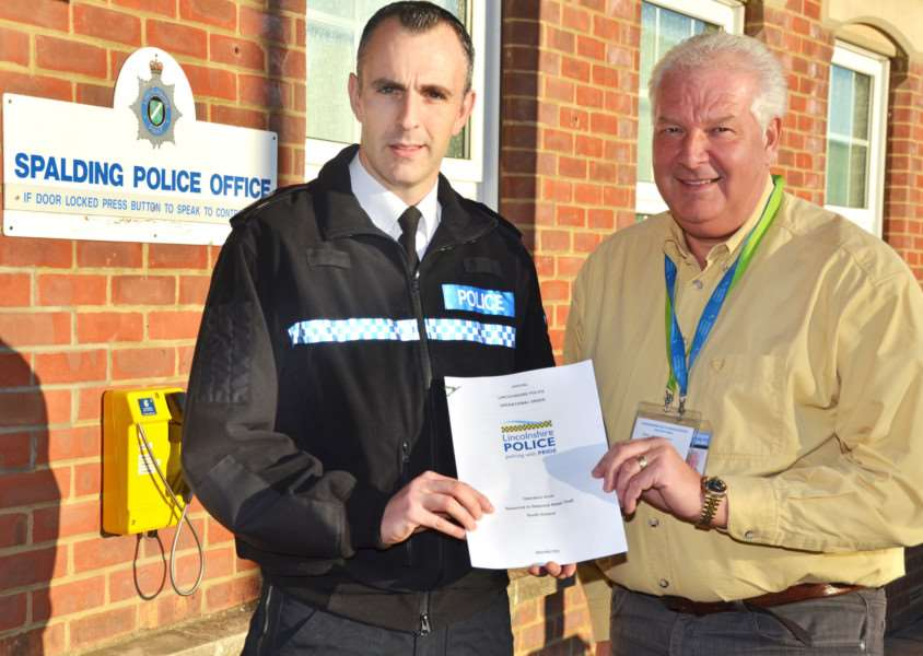 Inspector Gareth Boxall, neighbourhood policing inspector for South Holland, and Stuart Brotherton, coordinator of Shopwatch Spalding and Holbeach. Photo by Tim Wilson.''SG041217-105TW.
