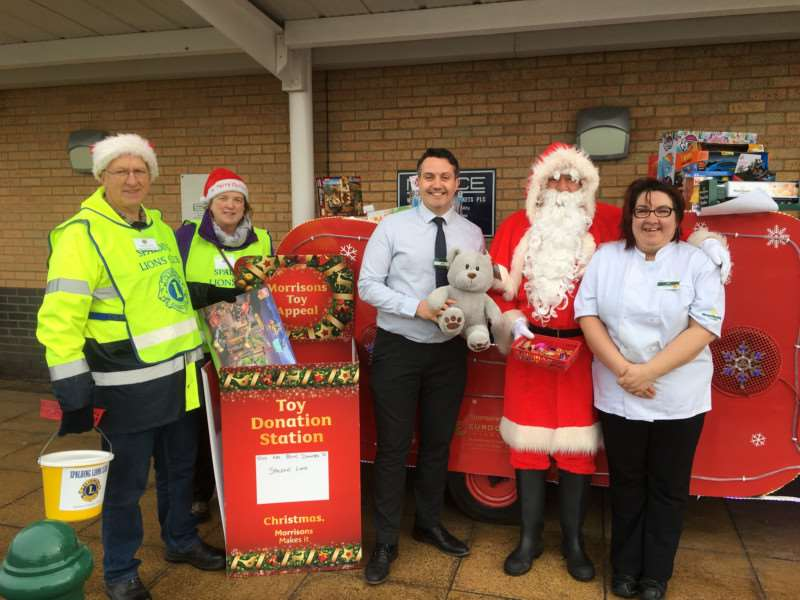 Lions John Steel and Eileen Robson, Morrisons manager Jason Savage, Santa and Morrisons community respresentative Gail Ridley.