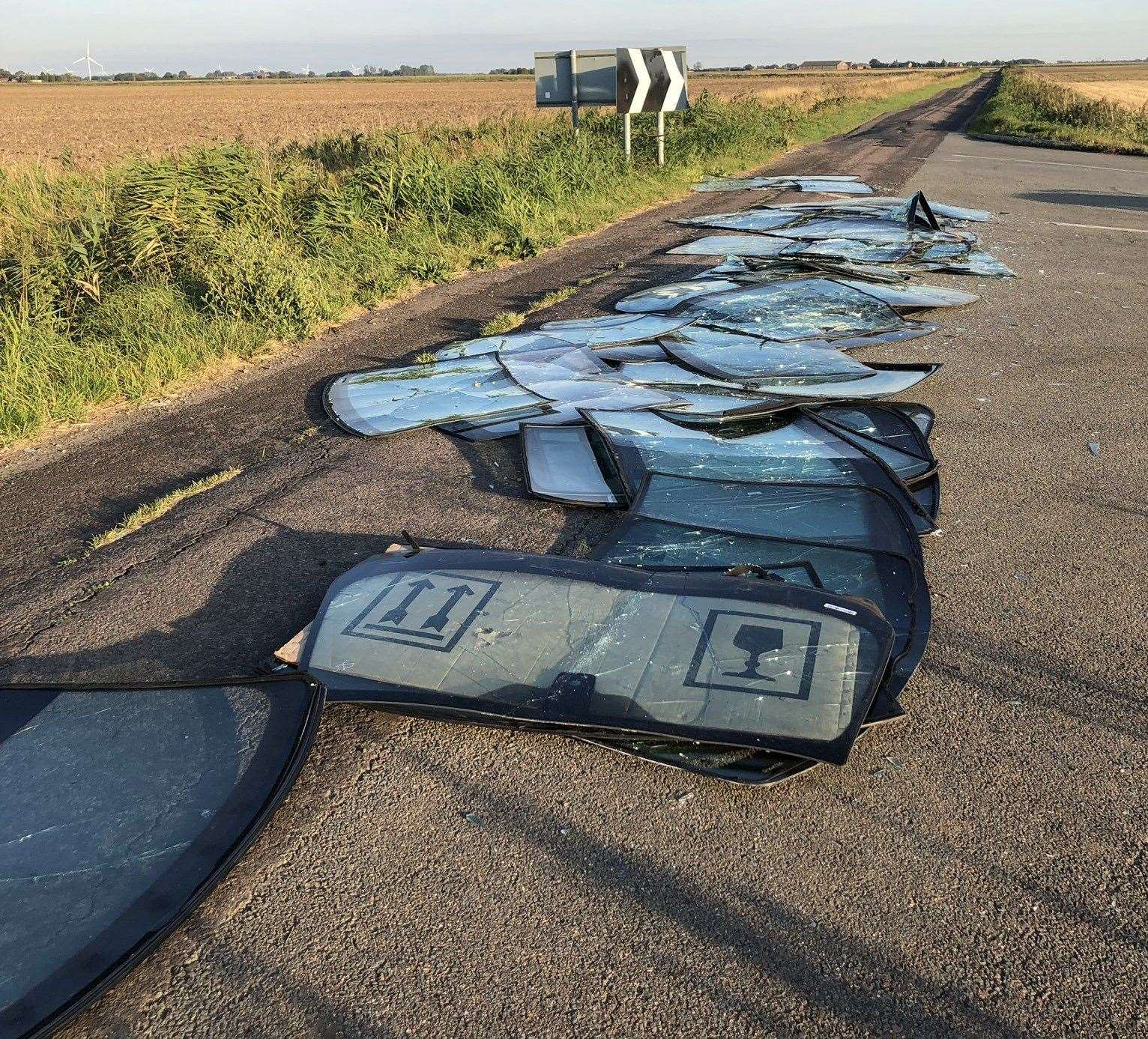 Car windscreens dumped at the junction of Green Drove and The Chase in Crowland. (17540127)