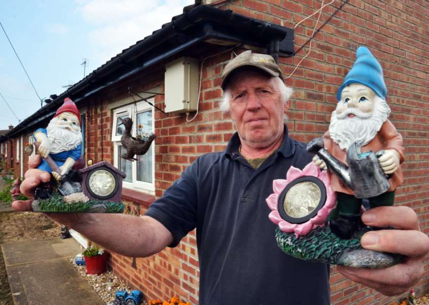 Frederick Burrows, outside his bungalow with gnomes keeping watch, after ornaments have gone missing. (SG260917-207TW)