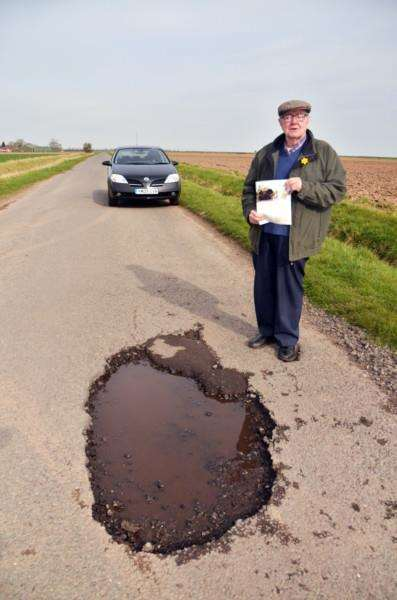 Thomas Edwards pothole, Gedney Drove End'Thomas with latest edition of LCC magazine article- action on potholes