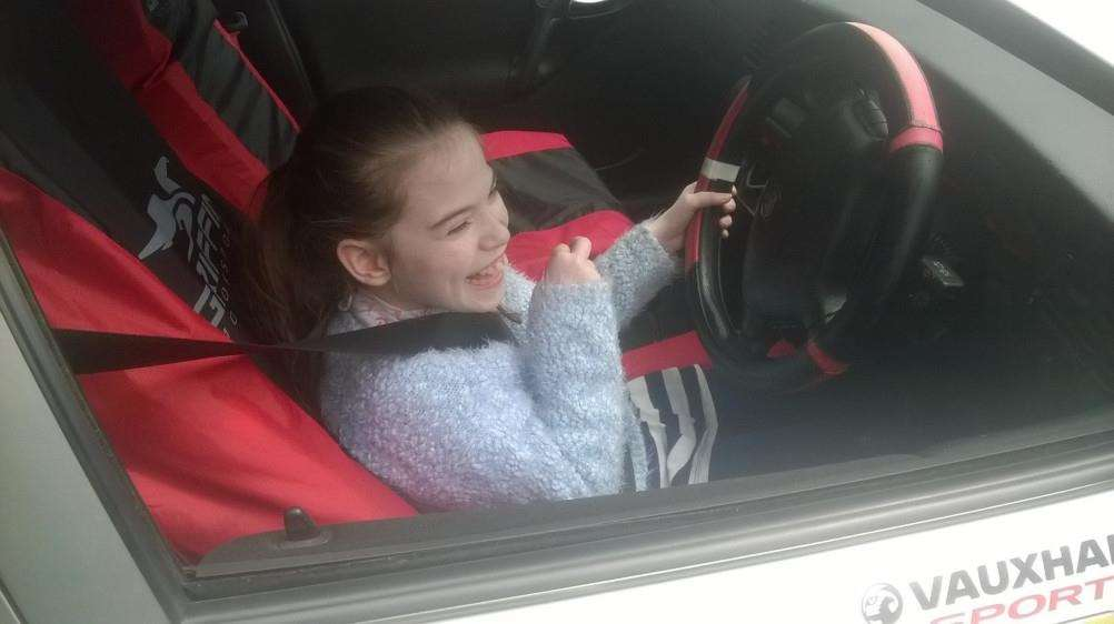 Alice Bates at the wheel of a fast racing car ... it was a case of trying out the driving seat.