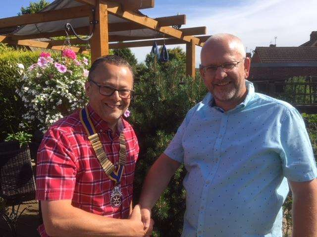 David Spenceley (left) receives the chain of office from outgoing president Nick Rangeley.