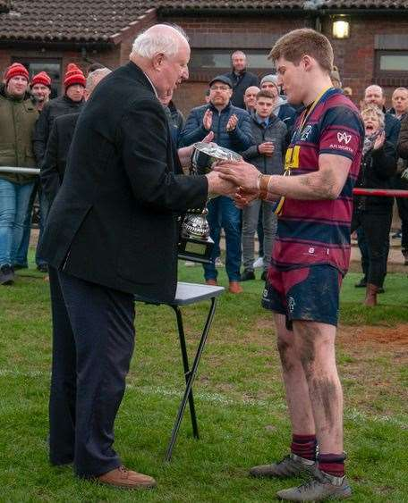 Spalding captain Dan Adams is presented with the Midlands RFU Senior Vase.Photo by Adrian Smith.
