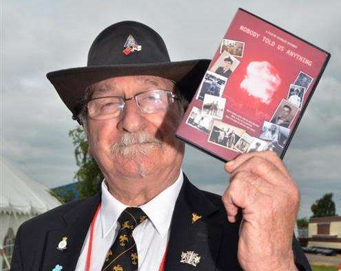 British nuclear test veteran Doug Hern with a DVD about his and other servicemen's experiences in the South Pacific during the 1950s and 1960s. Photo by Tim Wilson. SG190616-105TW. (2457167)