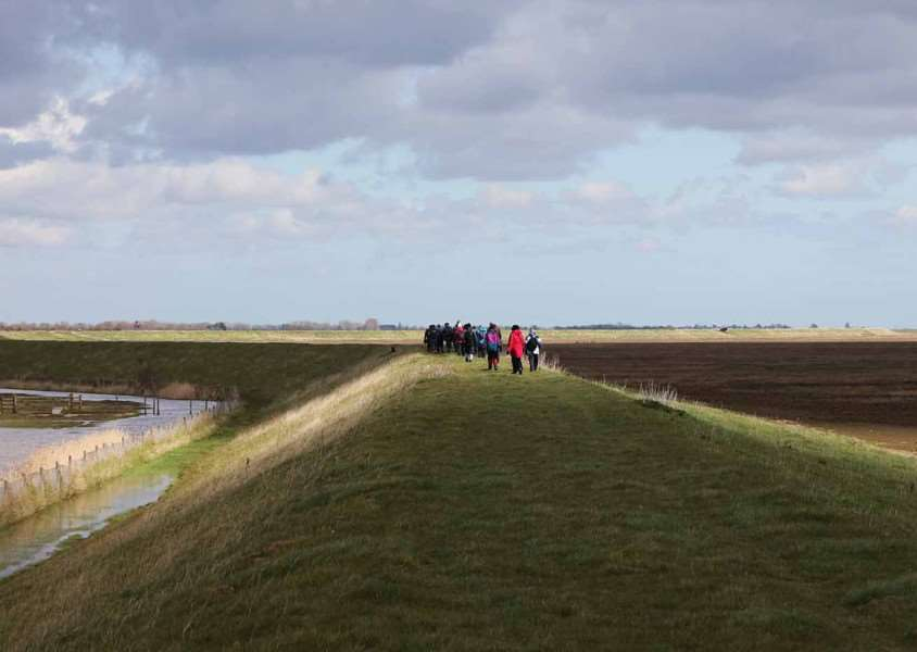 Ramblers on part of the proposed England Coast Path near Frampton Marsh nature reserve,