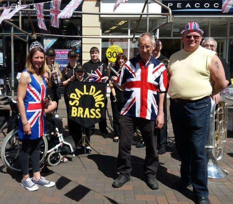 Shelley Andrew, Dave Burgess and Robin Myers, with Spalding Brass Band, as market day in the town marks the Royal Wedding. Photo supplied. (2095563)