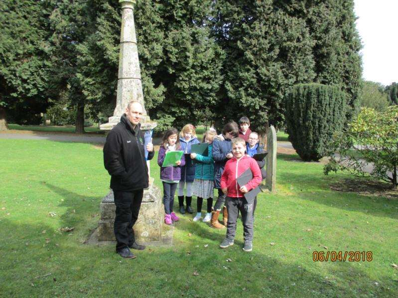 Karl Gernert of Act II with youngsters at Holbeach Cemetery Chapels.