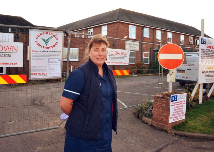 EXPANSION PLANS: Manager Maxine Winch in front of Holbeach Hospital where new rooms for residents will open in April. Photo by Tim Wilson. SG241117-153TW.