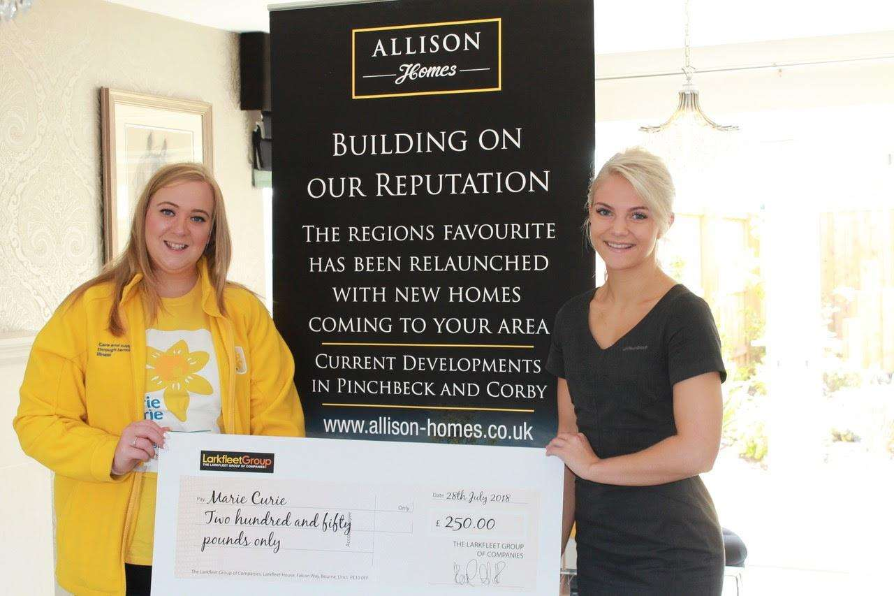 Lauren Alexander (left) from Marie Curie accepts the £250 donation from Allison Homes' Mallory Matthews. (3525415)