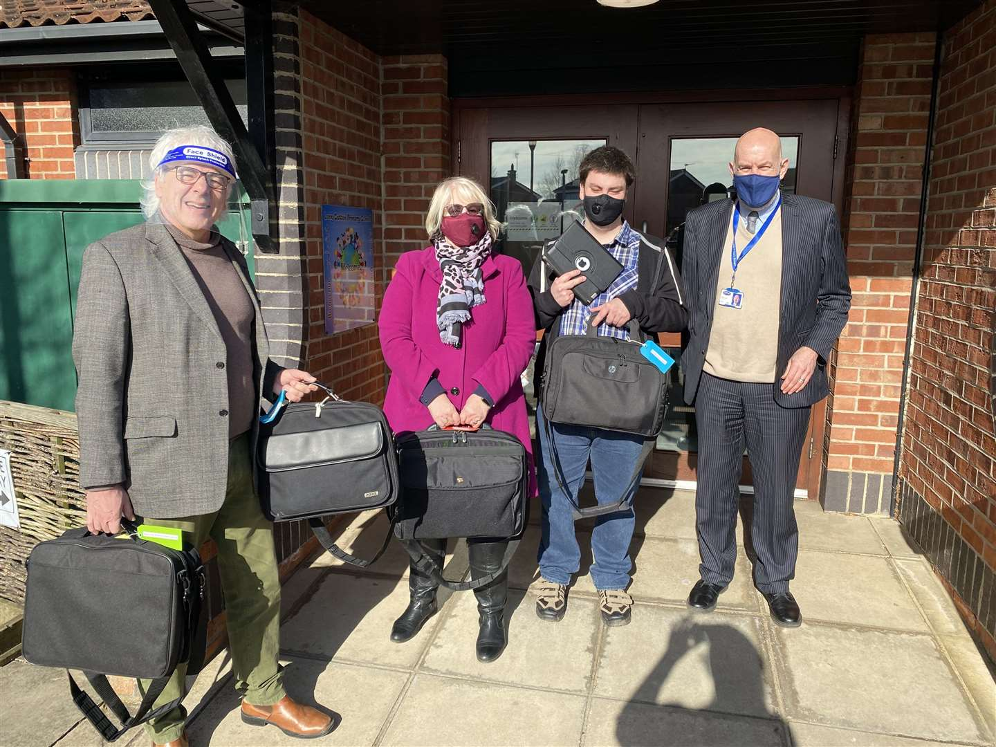 Gadgets are handed over to Bill Lord, headteacher at Long Sutton Primary School by Chris Carter, Patricia Wells and Josh Simson of Long Sutton Market House (44731047)