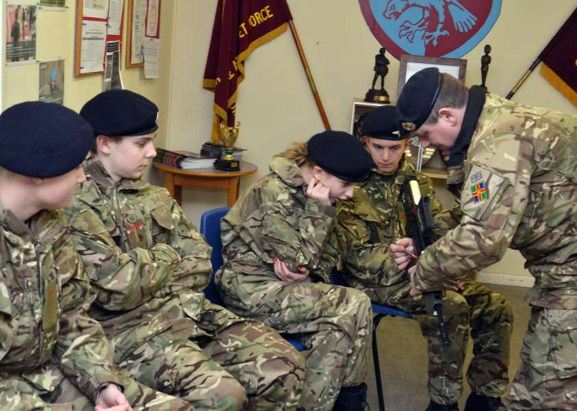 SSI Steve Walker leads the cadets through their weapons training. (SG150218-105TW).
