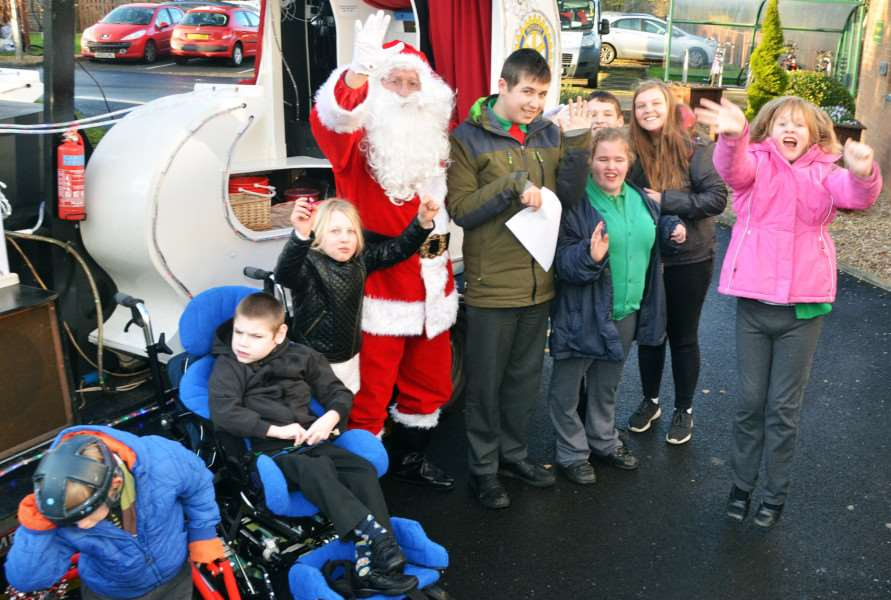 Garth School pupils excited to see Santa and be given sweets.
