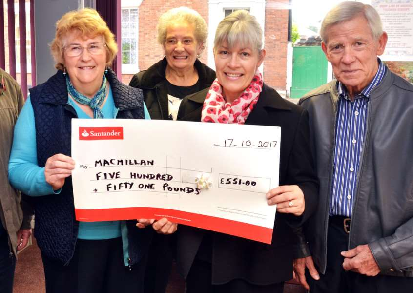 'ALL-ROUND GOOD PERSON': Vera Angelo (left) presents a cheque to Denise Vickers (second right) of Spalding and Holbeach Macmillan Cancer Support, joined by Liz and Peter Breach. Photo by Tim Wilson. SG031117-116TW.