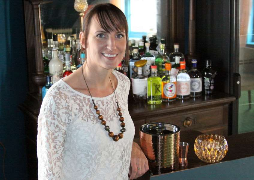 Dani Nundy behind the bar at The Gin Tree. Photo: Mark Le Sage