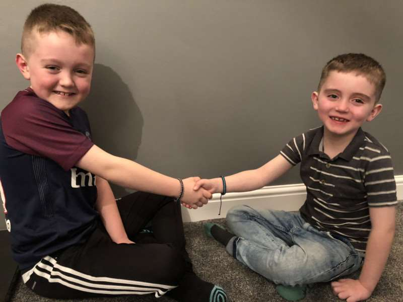 Ethan (left) and Lucas (right) with their wristbands