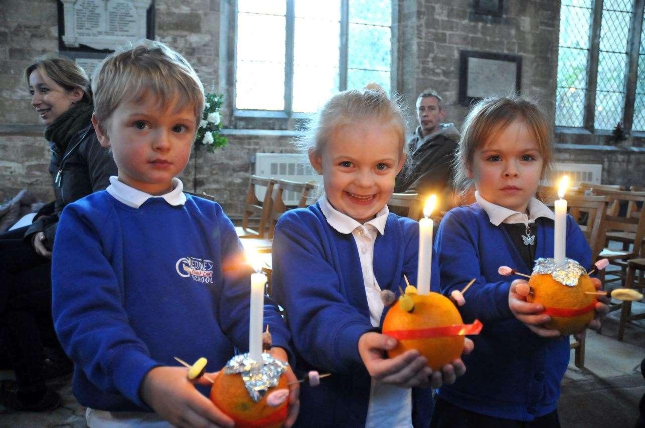 Christingles and happy faces lit up the church ...