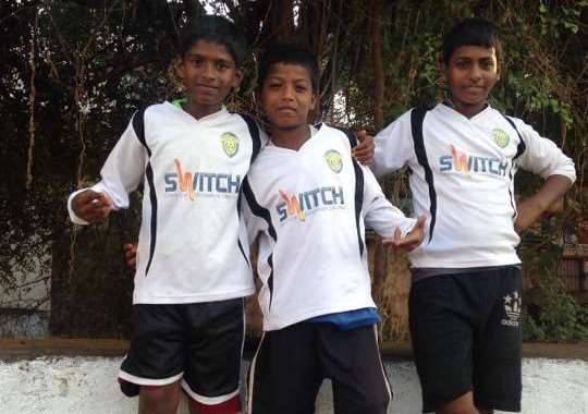TULIPS ABROAD: Youngsters in Goa try on their new Spalding United youth team kits, donated by Charlene Gay. Photo supplied.