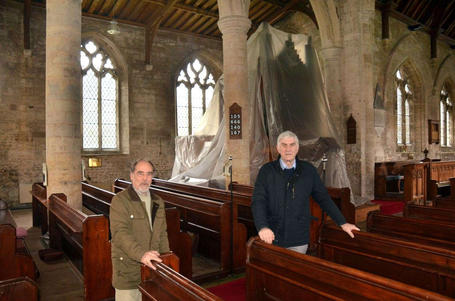 Peter Coupland (right) and parochial church council treasurer Peter Bush with the organ under sheeting