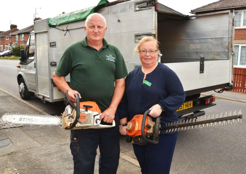 Tony and Mandy Caley with hedge trimmers saved because they were stored elsewhere. SG060917-127TW