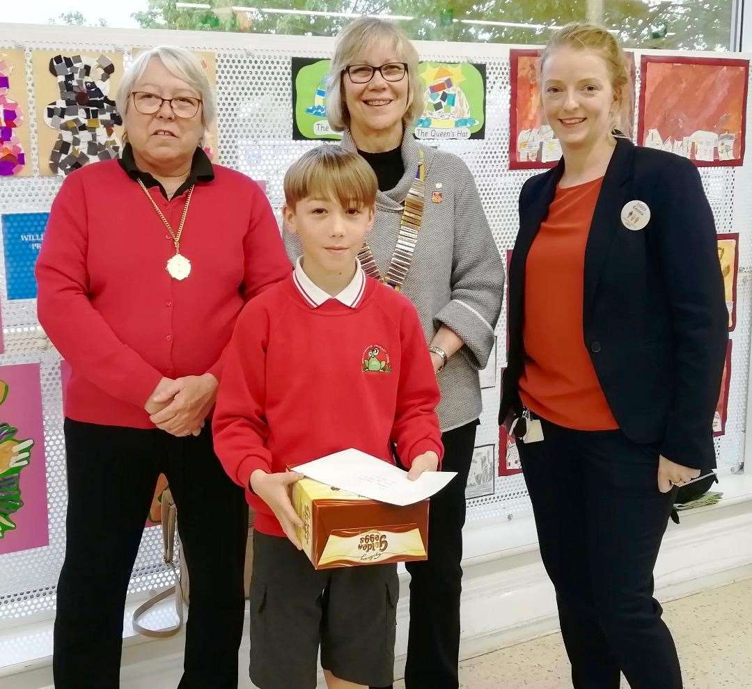 Winner of the Key Stage Two first prize Daniel Roberts of Northborough Primary School, with, from left, Councillor Xan Collins, Rotary President Jenny Spratt and Emma Ward of Tesco. (10664248)