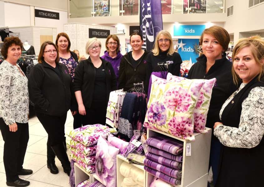 Store staff with the Coningsby Military Wives Choir. SG181117-175TW