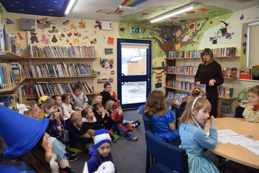 School governor Jo Sherry talks to pupils in the library she has painted