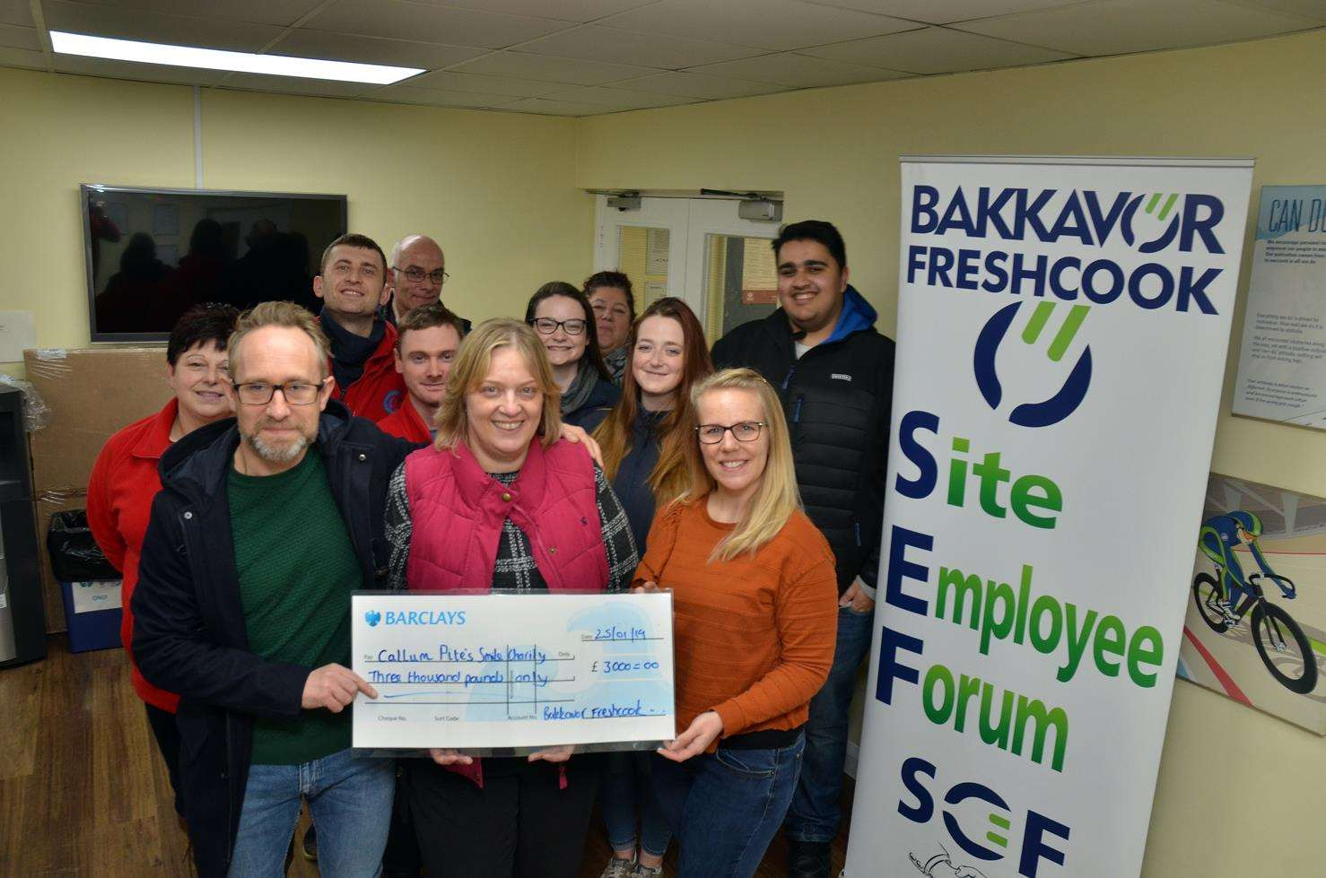 Bakkavor Freshcook factory manager Jonathon Wheatley presents the cheque to Michelle Pite with charity nominator Emma Rose and staff fundraisers.